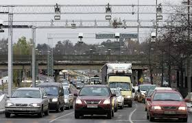 essay it s time to rethink how the world s great cities manage cameras monitor in traffic at the norrtull entry to stockholm in 2005 image getty