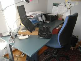 home office archives. Desk And Chair Set Up With Laptop On A Riser Surrounded By Various Paperwork Home Office Archives
