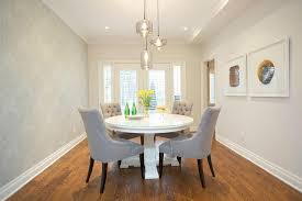 dining room with wallpapered accent wall