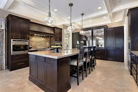 image of dark kitchen cabinets with light floors