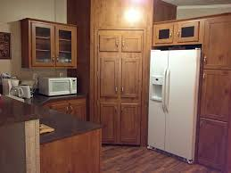 6 doors tall corner kitchen pantry cabinet and white double doors refrigerator full size