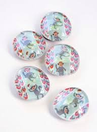 learn how to make these easy personalized magnets using washi tape flat glass marbles