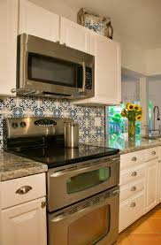 i love the blue and white hand painted tile to pop against the white cabinets