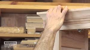 woodworking diy project installing crown molding on a cabinet you