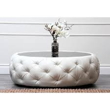 White leather coffee tables Storage Ottoman Glass Top Ottoman Coffee Table In Round Shape And Covered By Tufted White Leather Homesfeed Unique And Creative Tufted Leather Ottoman Coffee Table Homesfeed