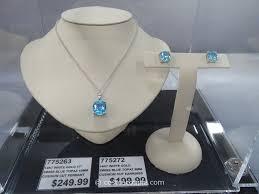 swiss blue topaz 14 kt cushion cut pendant and earrings costco 1