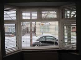 Bay Window Blinds Or Curtains  NrtradiantcomBay Window Vertical Blinds