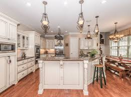 Rustic white kitchens Brown Kitchen With Distressed White Cabinets With Antique Door Hardware And Red Oak Floors Designing Idea Rustic Kitchen Cabinets ultimate Design Guide Designing Idea