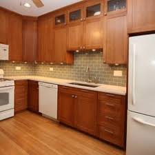 kitchens with wood cabinets and white appliances. Delighful Appliances White Appliances  This Kitchen Remodel Made The Design Work By Using  Cherry Wood Cabinets A U201cOysteru201d CaesarStone Quartz Countertop With An Eased  In Kitchens With Wood Cabinets And White Appliances C