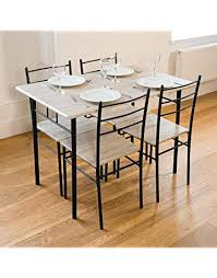 Unique dining room chairs Kitchen Cecilia Piece Dinner Table And Chairs Set Modern Dining West Michigan Mixed Martial Arts Academy Dining Table Sets Shop Amazon Uk