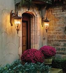 exquisite lighting. kichler outdoor lighting and design with stone wall big potted plants plus lantern sconces exquisite i