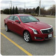 Red Cadillac Driving Down The Street: The Cadillac ATS ...