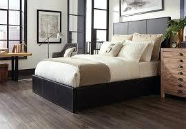 laminate wood flooring bedroom dark planks of wood look vinyl flooring in a master bedroom home