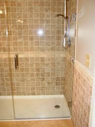 marble tile wall with glass door for corner shower stalls in bathroom design ideas