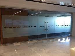 monumental tinted glass door green tinted glass wall with frosted sliding door interior most