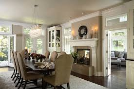 Dining Room with renovated two sided fireplace into Porch  traditional-dining-room