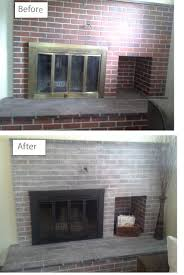 a slightly white washed fireplace updated the outdated brass insert with black paint