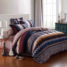 navy blue orange and brown aztec zigzag stripe geometric pattern blue and orange bedding