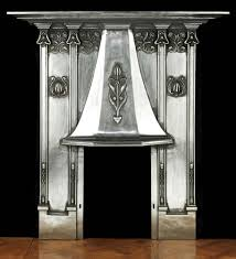 art nouveau tall slender and elegant burnished cast iron art nouveau fireplace with typical asymetric