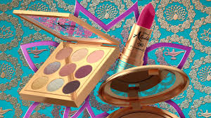 m a c aladdin makeup collection on a colorful background