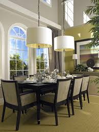 casual dining room lighting idea with low ceiling double white drum shade pendant lamps over black dining table and upholstered dining chairs