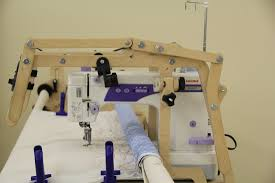 Used Longarm Quilting Machines - Accomplish Quilting & Janome 1600P on 8' Little Gracie II wooden frame with canvas leaders and  Pattern Perfect set. Adamdwight.com