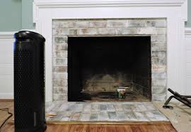 now that you ve cleaned it white washed it given a fresh coat of heat resistant paint to the inside you have what looks like a brand new fireplace