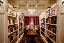 traditional family room designs. Brown Armchair In Great Traditional Family Room Design With Ceiling Beams And House Of Troy Also Built Bookshelves Globe Chandelier Library Designs