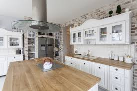 white country kitchen with butcher block.  Country Opted For White Custom Cabinetry That Looks Like Freestanding  Furniture They Removed Plaster Walls To Expose Beautifully Weathered Brick Butcherblock For White Country Kitchen With Butcher Block G