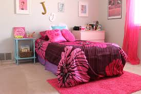bedroom pink fl bedding set on the bed and pink fur rug connected by smooth