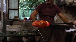making murano glass statue in murano glassblowing work in venice italy