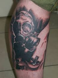 Black And Grey Gas Mask Tattoo On Leg For Men