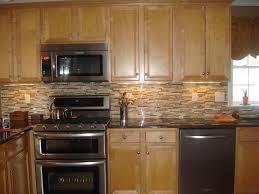 stainless steel appliances mosaic tile backsplash black granite countertop kitchen color ideas with oak cabinets design ideas