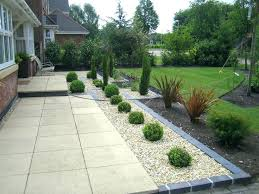 brick garden edging. garden edging border grey slate chippings in the bricks . brick