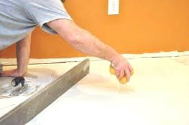 how to lay tiles on concrete laying tile on concrete floor describes how to level a