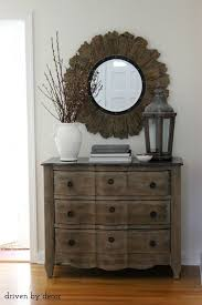 entry chest furniture. Weathered Foyer Chest || Ceramic Jug With Flowering Branches Lantern Round Wood And Iron Mirror Entry Furniture Pinterest