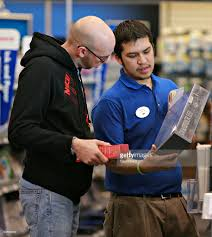 best buy s associate josh flores left assists chad cox best buy s associate josh flores left assists chad cox a device to
