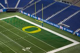 the oregon end zone s paint job nears completion the alamodome is prepared for valero alamo