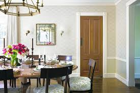 nice lines molding helps create a sense of scale in this dining room decorated by