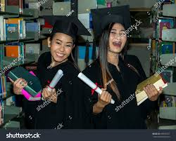 group happy asian graduates holding diploma stock photo  group of happy asian graduates holding diploma in library happy group of young asian graduate