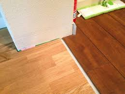 Uneven Kitchen Floor How To Install Baseboard At The Transition Between Floors With