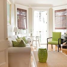 A rather neutral living room dcor featuring bursts of green A ...