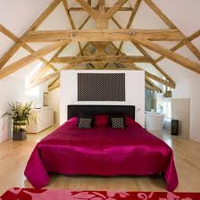 glamorous bedroom furniture. Double Bed With Red Satin Cover In A Large Room Glamorous Bedroom Furniture E