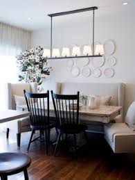 banquette setup idea for breakfast nook plate wall banquette bench table two chairs on other side garage entry and laundry doors on either side of