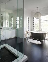 glam crystal globe chandelier over black cast iron bathtub