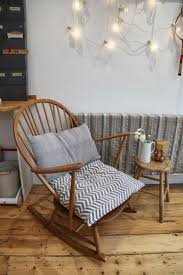 rocking chair in living room. re-stain rocking chair-- same pillow scheme chair in living room