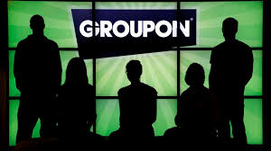 employees at groupon pose in silhouette with the company logo in the lobby of the
