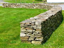 field stone walls and fire pits