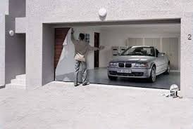 garage doors have until now mostly been mouse grey and ugly and often spoil the appearance of well maintained homes but now the days of those hideous
