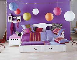 l elegant look of white wooden bed with double drawers connected by small white shleves on purple wall theme combined by assorted color lanterns